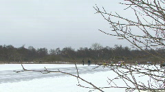 Speed ice skaters race by Stock Footage