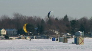 Kiting on a snowboard on one of Michigan's many frozen lakes Stock Footage