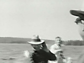 Men and children in a boat on the lake--From 1930's film Stock Footage