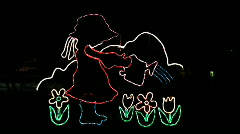 Illuminated Animated Little girl watering flowers Stock Footage