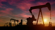 Oil rigs at sunset Stock Footage