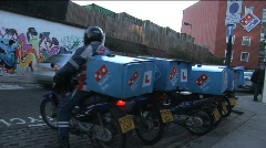Pizza delivery man on moped Stock Footage