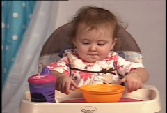 Fussy baby throws food Stock Footage