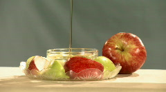 Apple in honey 4 Stock Footage