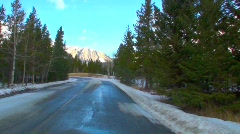 bow valley mountains trees clouds driver perspective - stock footage