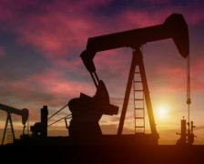 Oil rigs at sunset (PAL) Stock Footage