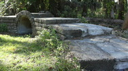 Walking Across Old Stone Foot Bridge Stock Footage