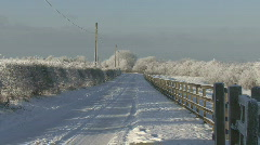Snowy country lane Stock Footage