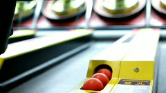 Playing Skee Ball Stock Footage