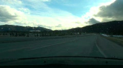Driver view cloverleaf onto freeway 4x speed Stock Footage
