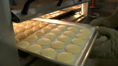 Professional baker rotates cookies in oven Stock Footage