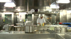 Professional Cook in Restaurant Kitchen Stock Footage