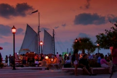 Sail boat pases behind the famous Key West Sunset Celebration Stock Footage