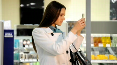 Girl with cosmetics powder in mall - stock footage