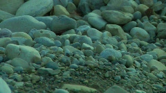 Rocks and boulders strew the shore Stock Footage