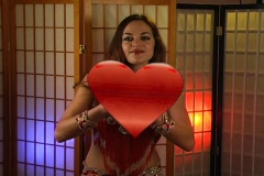 Beautiful Exotic Belly Dancer with Heart Graphic (1) Stock Footage
