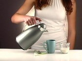 Stock Video Footage of Woman Pouring Coffee, Studio Setup (1a)