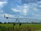 Irrigation farm equipment watering a field Stock Footage