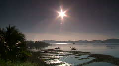 Outrigger Boats on anchors in the morning sun Stock Footage