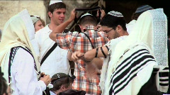 Western Wall - a jewish man is Putting on tefillin 2 Stock Footage