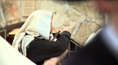 Western Wall - a jewish man is Putting on tefillin Stock Footage