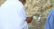 Stock Video Footage of Western Wall - a man is praying 7
