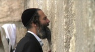 Stock Video Footage of Western Wall - a man is praying 6