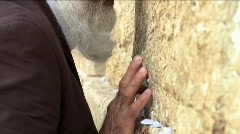 Western wall - An old man praying Stock Footage
