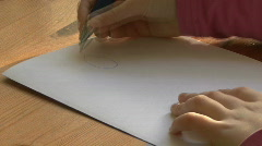 Child draws a female figure  Stock Footage
