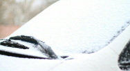 Automobile brushes clean glass from snow. Stock Footage