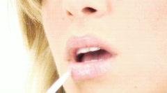 Female Face Beautiful soft lips -1 - applying lip gloss Stock Footage