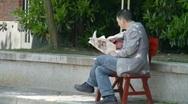 Reading Newspaper Stock Footage