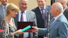 Yuri Luzhkov  passing the symbolic key from the new apartment building Stock Footage