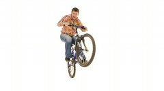 Boy riding bike on white background  - stock footage