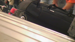 Air passengers collect luggage Stock Footage