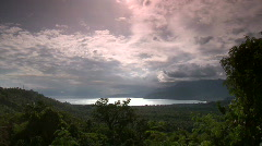 Overview over fertile green ocean bay valley with forest and palm trees Stock Footage