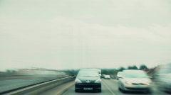 Speeding down road - stock footage