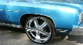 Big 22 Inch Chrome Wheel On A Classic Car In A Parade Footage