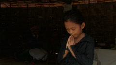 Laos: Ethnic Minority Girl Prays - stock footage