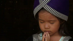 Laos: A little girl praying Stock Footage