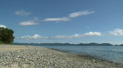 Beautiful pebble Beach with calm ocean swell Stock Footage
