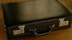 Briefcase full of money, US currency Stock Footage