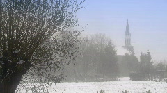 Winterscene: Church with tree (willow) in foreground Stock Footage
