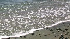 Ocean turvota rullaa hieman on hiekkaranta Arkistovideo