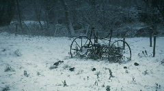 Winterscene: antique agricultural machine in the snow Stock Footage