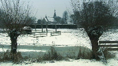 Winterscene: Church with trees (willows) in foreground Stock Footage