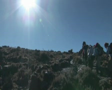 Hikers uphill in sun Stock Footage
