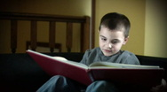 Boy and Book 504 Stock Footage