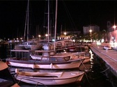 Boats in a Harbor at Night Stock Footage