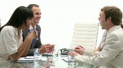 Business team in a meeting being led by a senior businessman Stock Footage